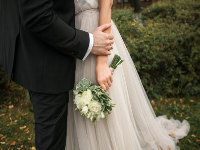 Bride holding flowers at wedding
