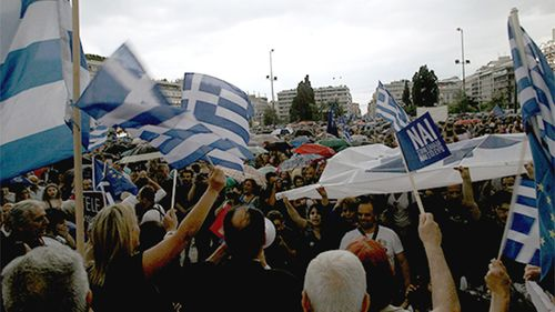 Queues were reported at every ATM in Athen's on Friday with a 60 euro limit per person per day imposed. (Supplied)