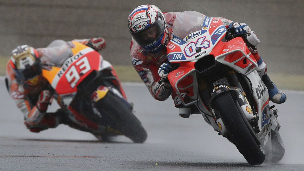 Ducati rider Andrea Dovizioso edges Marc Marquez in rain-soaked MotoGP thriller in Japan