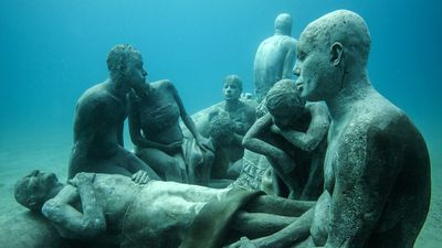 """<em>Raft of Lampedusa</em>: a harrowing depiction of the ongoing humanitarian crisis, referencing French Romantic painter Théodore Géricault's work: <em>The Raft of the Medusa</em>."" (Jason deCaires Taylor)"