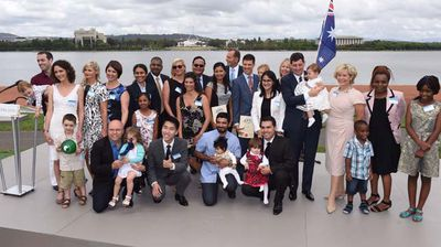 The PM welcomes a group of new Australian citizens in the nation's capital. (AAP)
