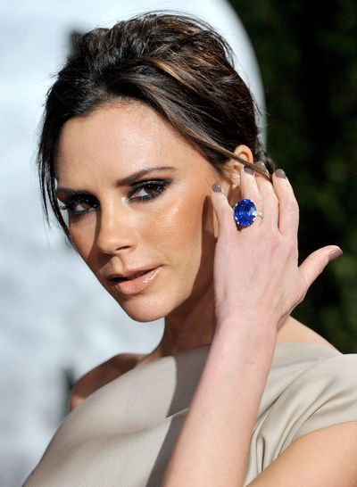 Mrs Beckham moved into sapphires in 2010 with this huge oval-cut sapphire on a platinum pave band.