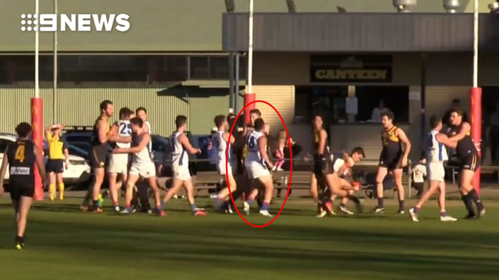 9RAW: Watch the moment AFL staffer Ali Fahour strikes a Whittlesea player