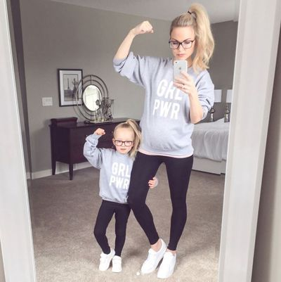 <p>Part of the fun of having a daughter is twinning. From matching outfits to hairstyles - even pulling the traditional 'fish-face' in selfies.</p> <p>We've pulled together a collection of big-name celebrity mummies and influencers  who love playing copy cat style with their daughters.</p> <p>Just like lifestyle blogger Kate Weilz and her sweet daughter pictured here, both rocking Girl Power Ts and high pony tails.</p> <p>Swipe through for more mother/daughter mirror-image styling ...</p>