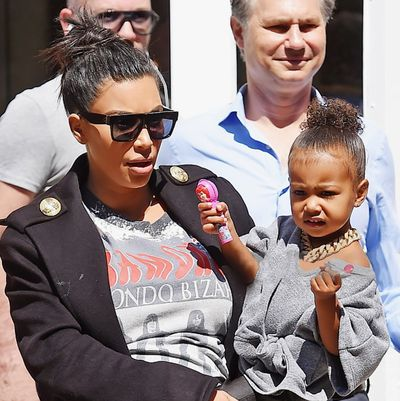 Kim Kardashian favours topknots for a casual outing with North.