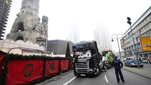Murder weapon: Experts examine the scene around a truck that crashed into a Christmas market in Berlin. Source: AFP