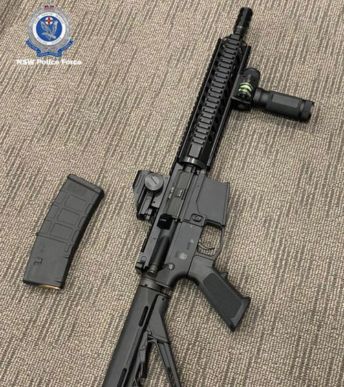 An M4 carbine automatic assault rifle seized during the raids.