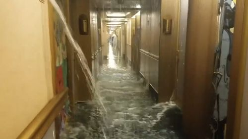 The water gushed into the hallways on deck 9 and into about 50 rooms. (Supplied)
