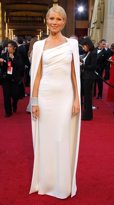 In an all-white Tom Ford gown and cape at the 2012 Oscars.