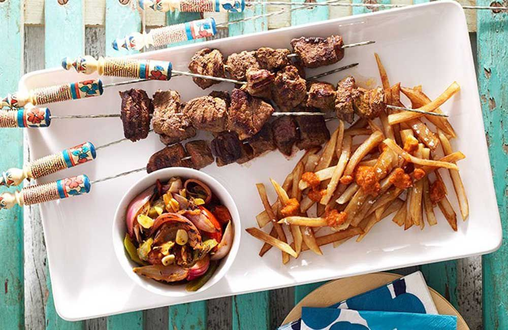Moroccan beef kebabs with harissa chips and grilled vegetable salad by Andy Harris. Image: Gourmet Traveller