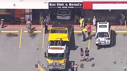 Elderly driver escapes without serious injury after car ploughed into shop north of Brisbane