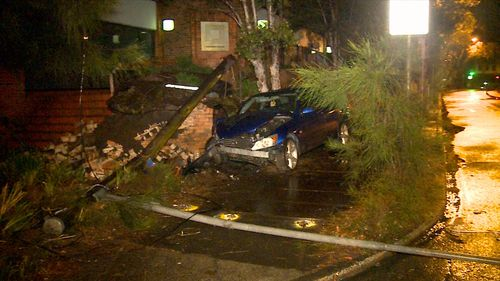Police are searching for the driver of a Lexus that crashed into a light pole in Sydney's north and fled the scene.