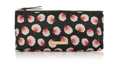 "<a href=""http://www.net-a-porter.com/us/en/product/504588""> Printed Canvas Cosmetics Case, approx. $257, Stella McCartney</a>"