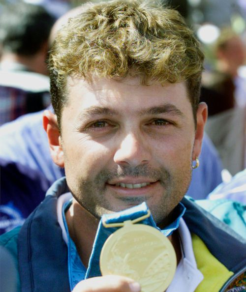Michael Diamond with the Olympic gold medal he won in 2000. (AAP)