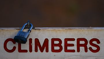 A lock is seen on the sign at the climbing area at Uluru, also known as Ayers Rock at Uluru-Kata Tjuta National Park.