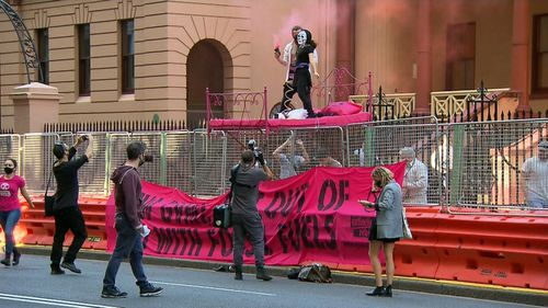 A protest is underway outside NSW Parliament.