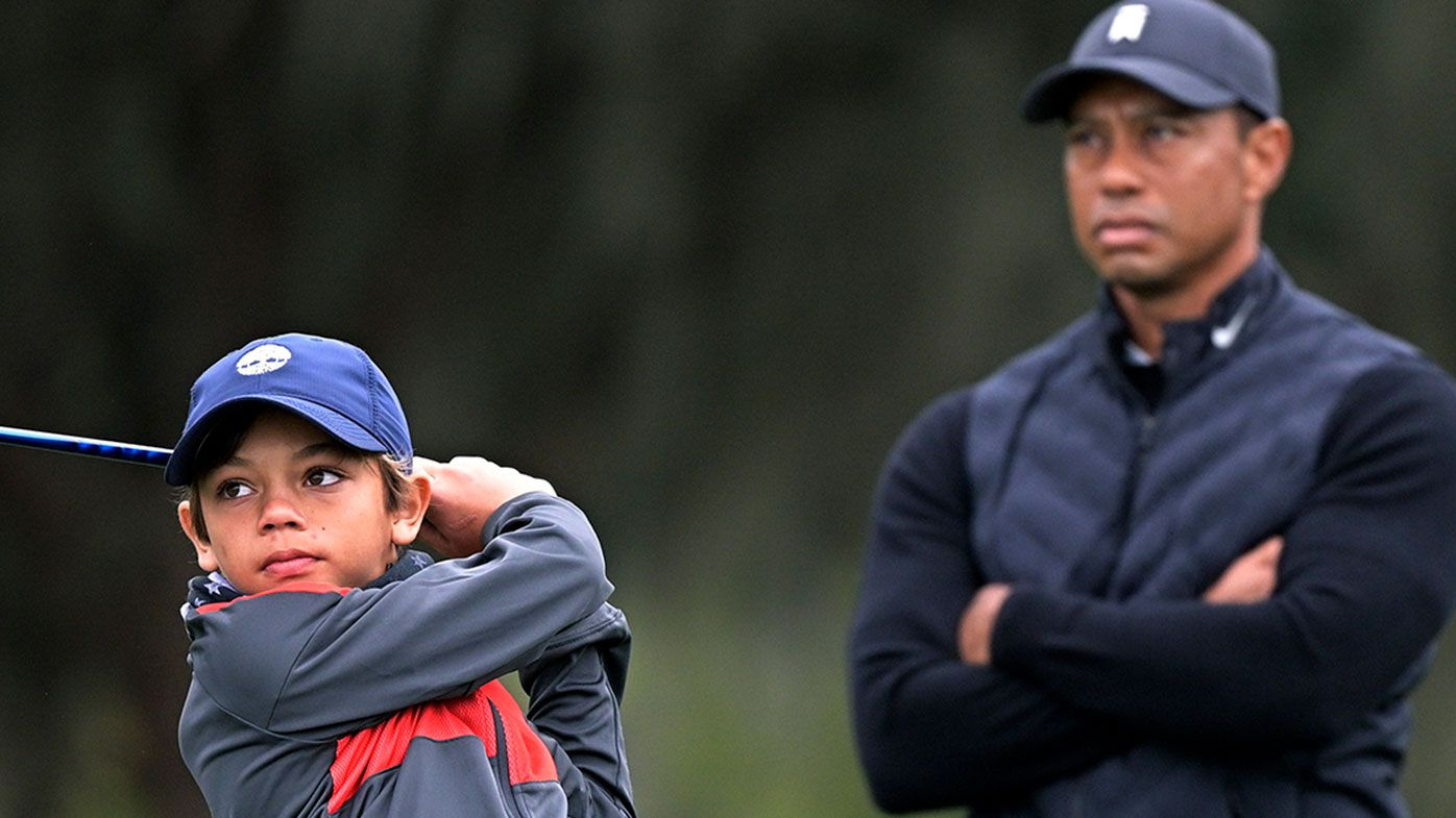 Tiger Woods watches son Charlie at the Father-Son Challenge golf tournament.
