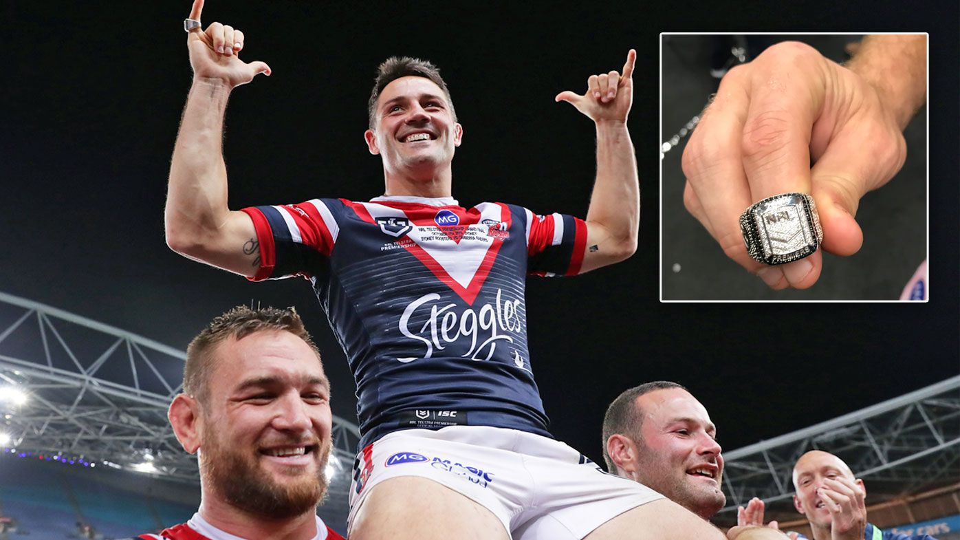 Cooper Cronk is carried off the field by teammates and inset, Mitch Aubusson models the 2019 NRL Premiership ring.