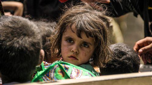 An Iraqi girl flees Mosul. (AFP)