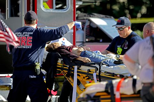 A victim is wheeled away in a stretcher. Picture: AAP