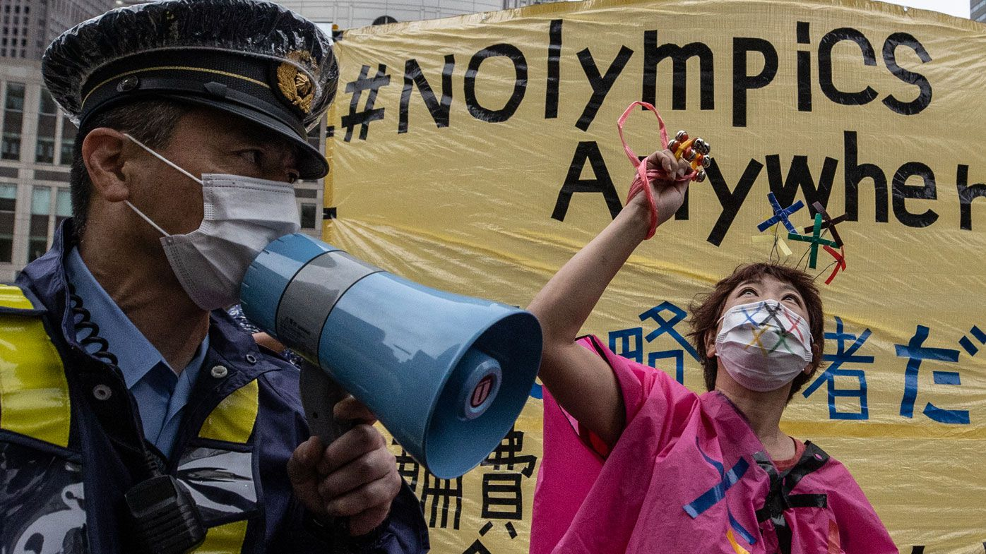 Protesters chant slogans outside the metropolitan government building during a protest against the Tokyo 2020 Olympic Games.
