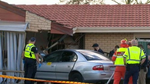 The car slammed into the lounge room of a house where two children were inside. (9NEWS)