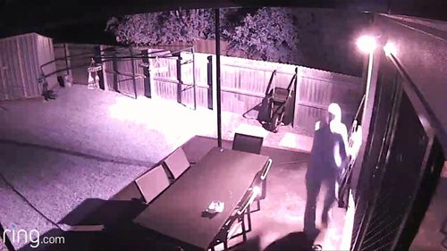 Using the security system, the homeowner is able to scare him off.