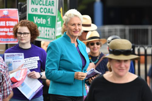 Independent candidate for Wentworth Kerryn Phelps is seen handing out how to vote cards at a polling place at Bellevue Hill.