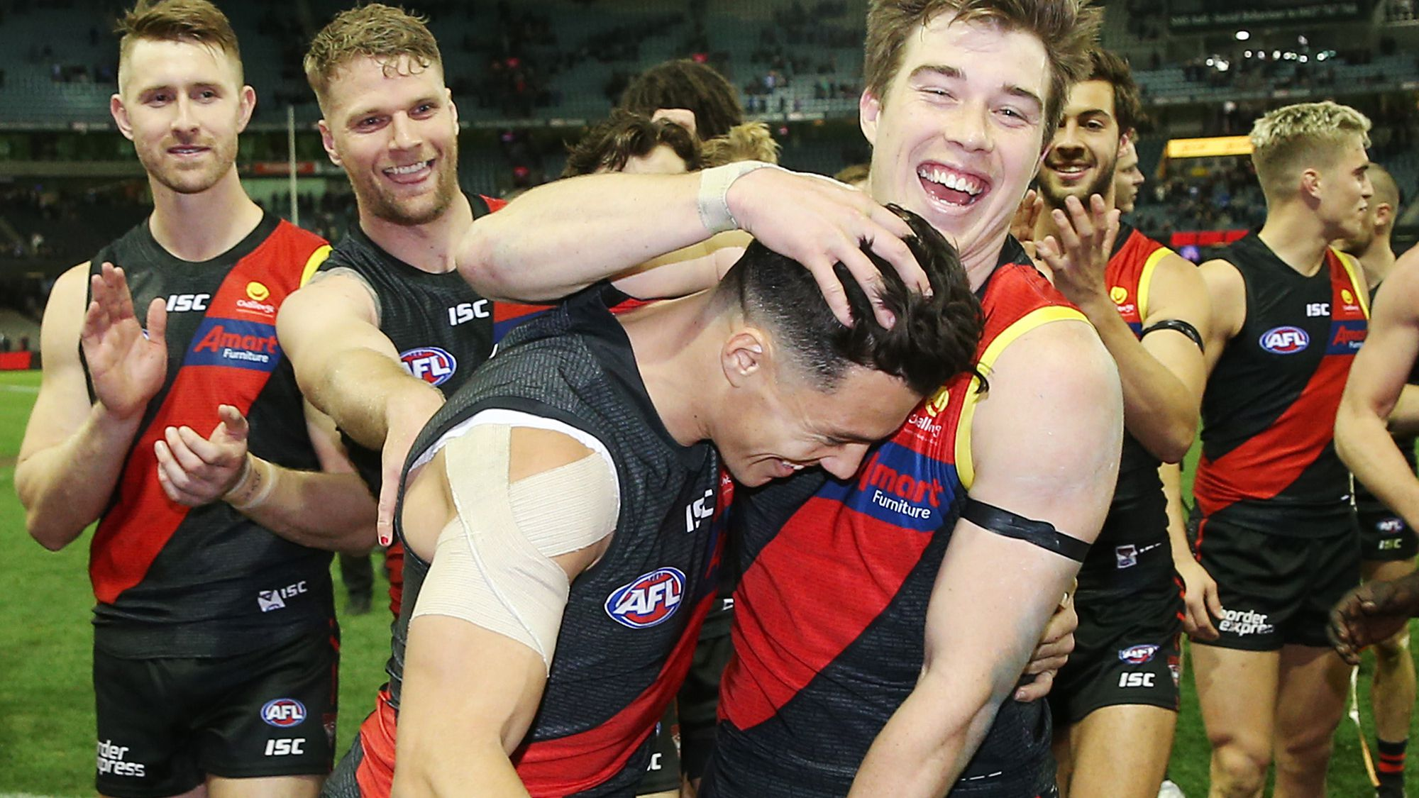 Dylan Shiel and his Essendon teammates celebrate a win.