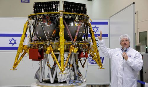Ofer Doron, director of Israeli Aerospace Industry Program with the space craft. (Photo: AP).