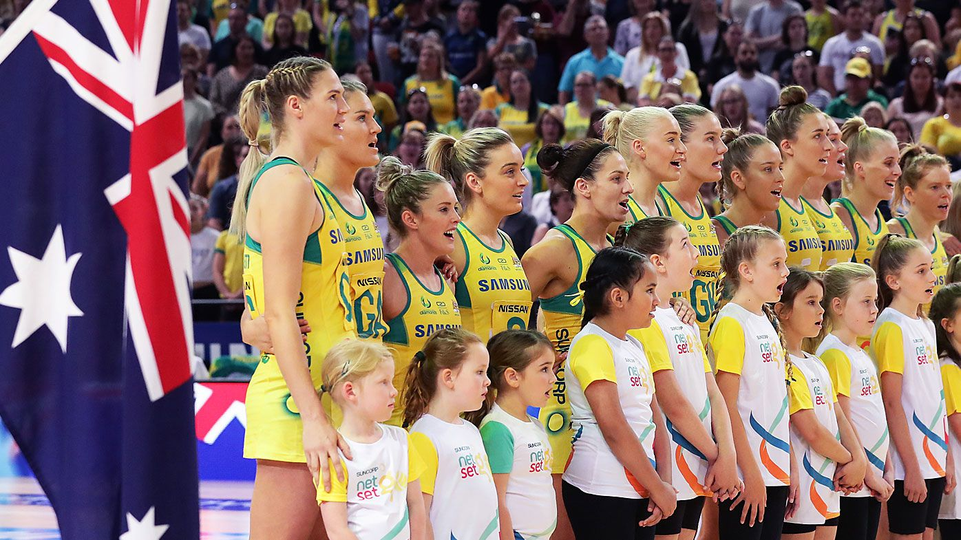 Aussie Diamonds line up for the national anthem