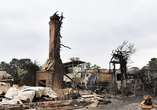 The burnt out remains of a house is seen from a bushfire in the Southern Highlands town of Wingello, 160km south west of Sydney