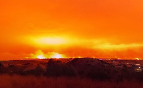 Firey red skies at the height of the blazes on Saturday night. . (Facebook: Hangingpixels Photo Art)
