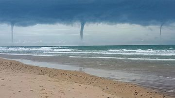 Waterspouts formed over Old Bar Beach on the NSW mid-north coast this afternoon.