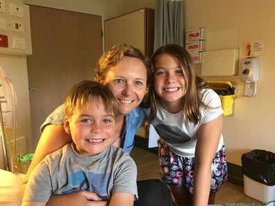 Tracey Lewis in hospital with her children