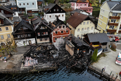 An aerial view made with a drone showing the damage and destruction caused by a fire during the night at the lakeside in the city of Hallstatt, Austria, 30 November 2019.