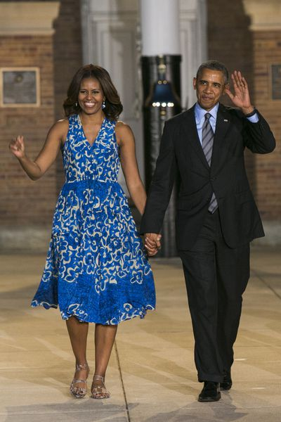 Stylish former First Lady Michelle Obama arrives to the Marine Barracks Evening Parade in Washington, D.C., on June 27, 2014 wearing the pretty blue frock again.