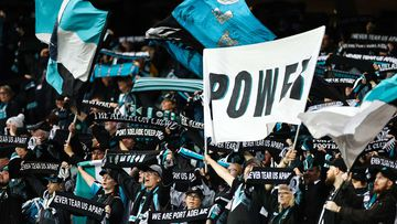 Port Adelaide Power fans celebrate during the round 17 AFL match between the Port Adelaide Power and the Essendon Bombers at Adelaide Oval.