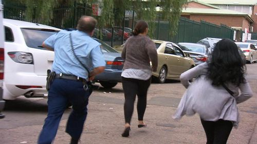 The woman was chased down by officers after running from Liverpool police station. (9NEWS)