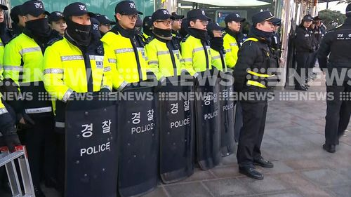 About 100 police officers were on hand to break up the demonstration. (9NEWS)