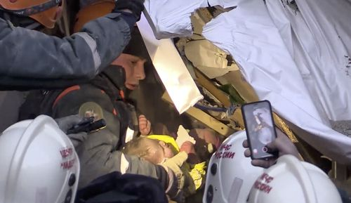 The moment the 10- month-old was saved from the wreckage of the apartments.