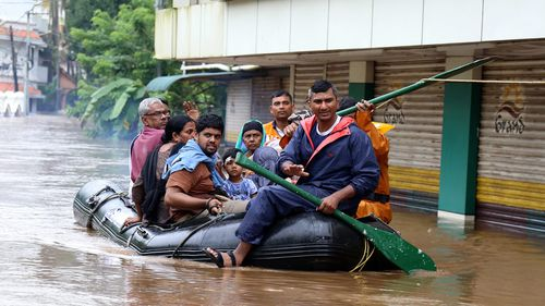 Heavy rains over the past eight days triggered flooding, landslides and home and bridge collapses, severely disrupting air and train services in Kerala state, a popular tourist destination with scenic landscapes, waterfalls and beautiful beaches.