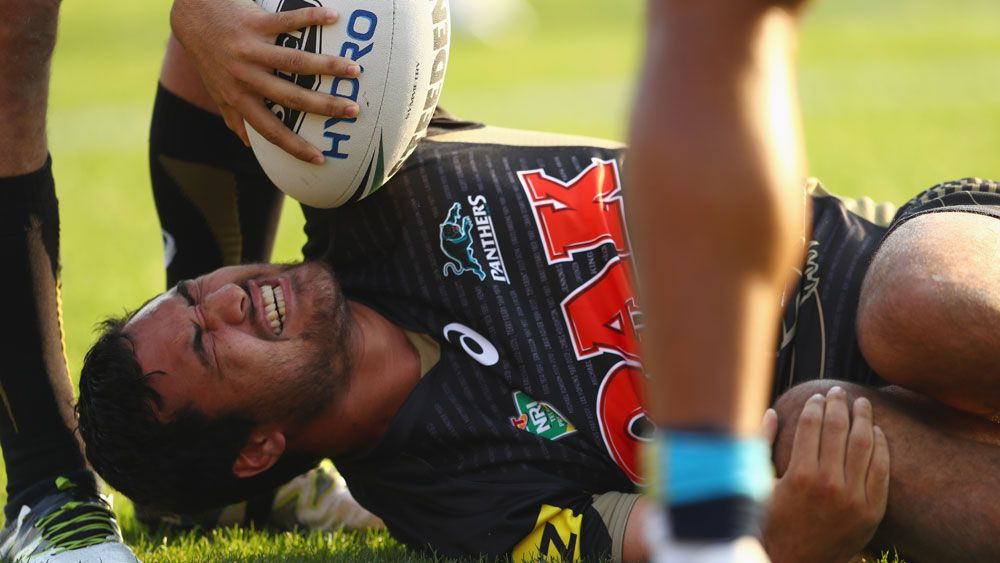 Peta Hiku writhes in pain after injuring his knee. (Getty)