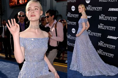 Elle Fanning, who plays Princess Aurora in the film, practises her Princess poses.