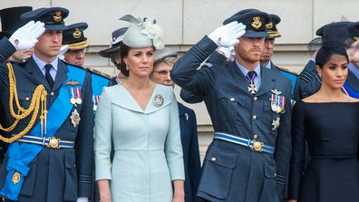 Fea0084046.DT News, Rota. Buckingham Palace. Centenary of the Royal Airforce. HM The Queen presents The RAF with new Queen's Colours of their centenary. Then watches with other members of the Royal Family a ply past