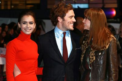 <i>Love, Rosie</i> co-stars Lily Collins, Sam Claflin and Suki Waterhouse get chummy on the red carpet.