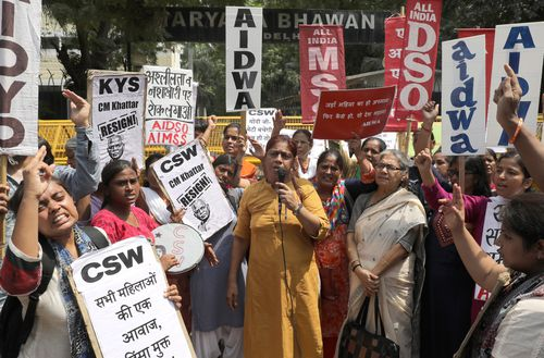 Indian activists shout slogans as they protest against the alleged gang rape of a 19-year-old girl in Rewari Haryana, in New Delhi, India, on September 17.