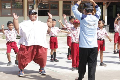 Arya Permana exercising at school with classmates in Karawang, West Java, Indonesia, March 2017 (Channel 5 / Barcroft Productions / Barcroft Media via Getty Images)