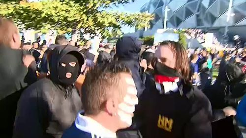 Victoria Police said football fans who cover their faces portray an image more aligned to criminals. (9NEWS)