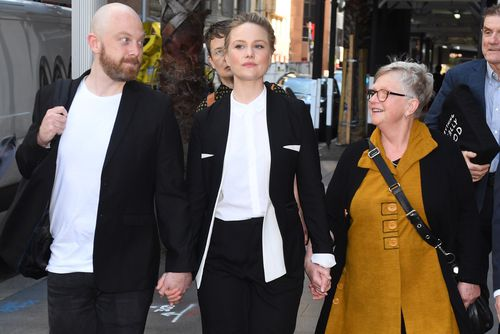 """Actress Eryn Jean Norvill (centre) said Rush's """"cheekiness"""" caused problems for her."""